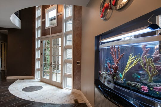 Foyer and one of the two fish tanks of the house in Shelby Township, Tuesday, Nov. 19, 2019.