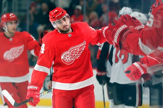 Detroit Red Wings center Robby Fabbri celebrates with teammates after scoring in the first period against the Ottawa Senators at Little Caesars Arena, Nov. 19, 2019.
