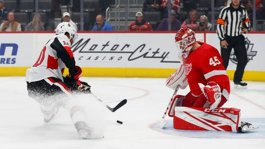 Senators left wing Anthony Duclair scores on Wings goaltender Jonathan Bernier during the first period Tuesday.