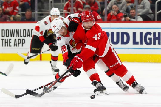 Ottawa Senators center Filip Chlapik and Detroit Red Wings center Darren Helm compete for the puck during the first period Tuesday, Nov. 19, 2019, in Detroit.