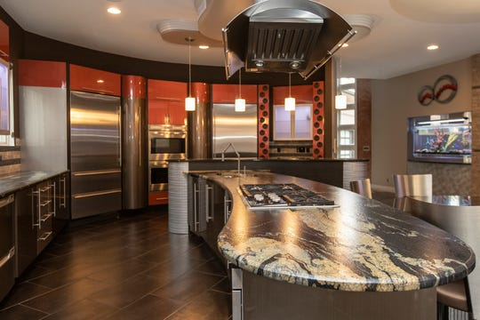 Kitchen with leather finish granite countertop of the house in Shelby Township, Tuesday, Nov. 19, 2019.