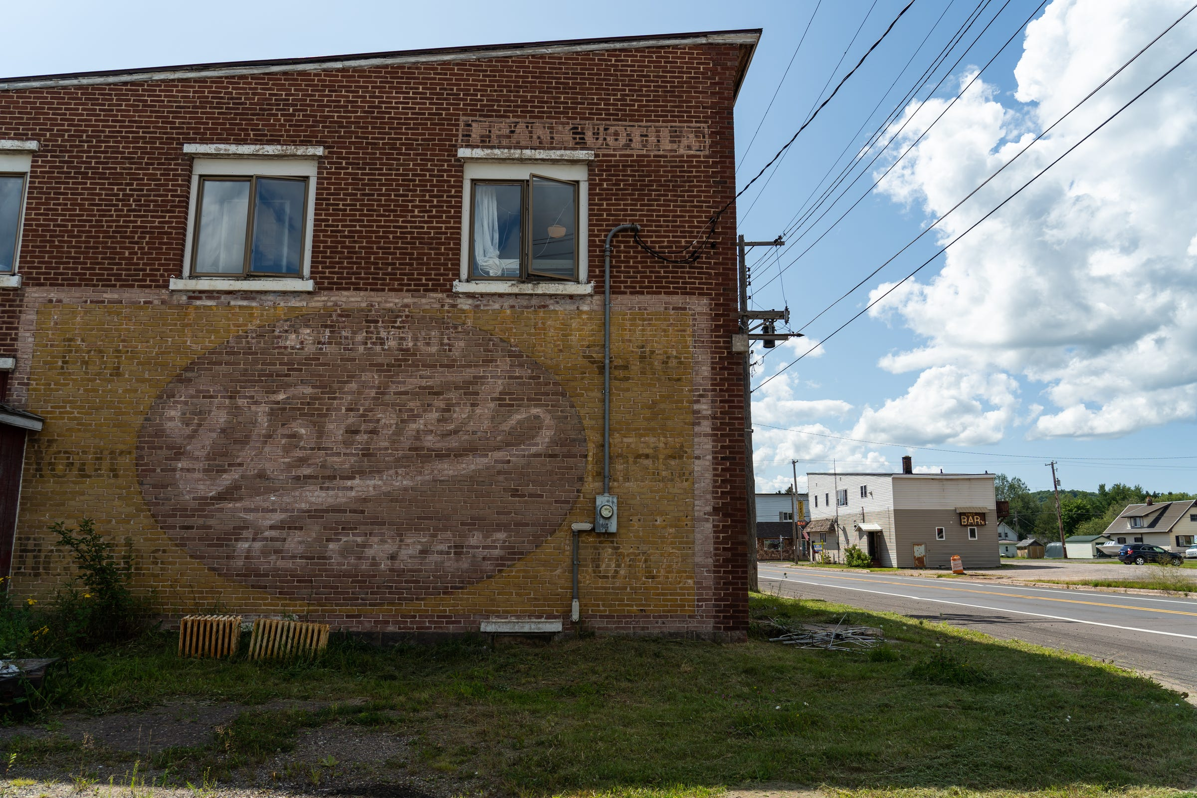A ghost sign remains on the side of a building along M-26 in Mass City on Thursday, Aug. 15, 2019 in Michigan's Upper Peninsula.