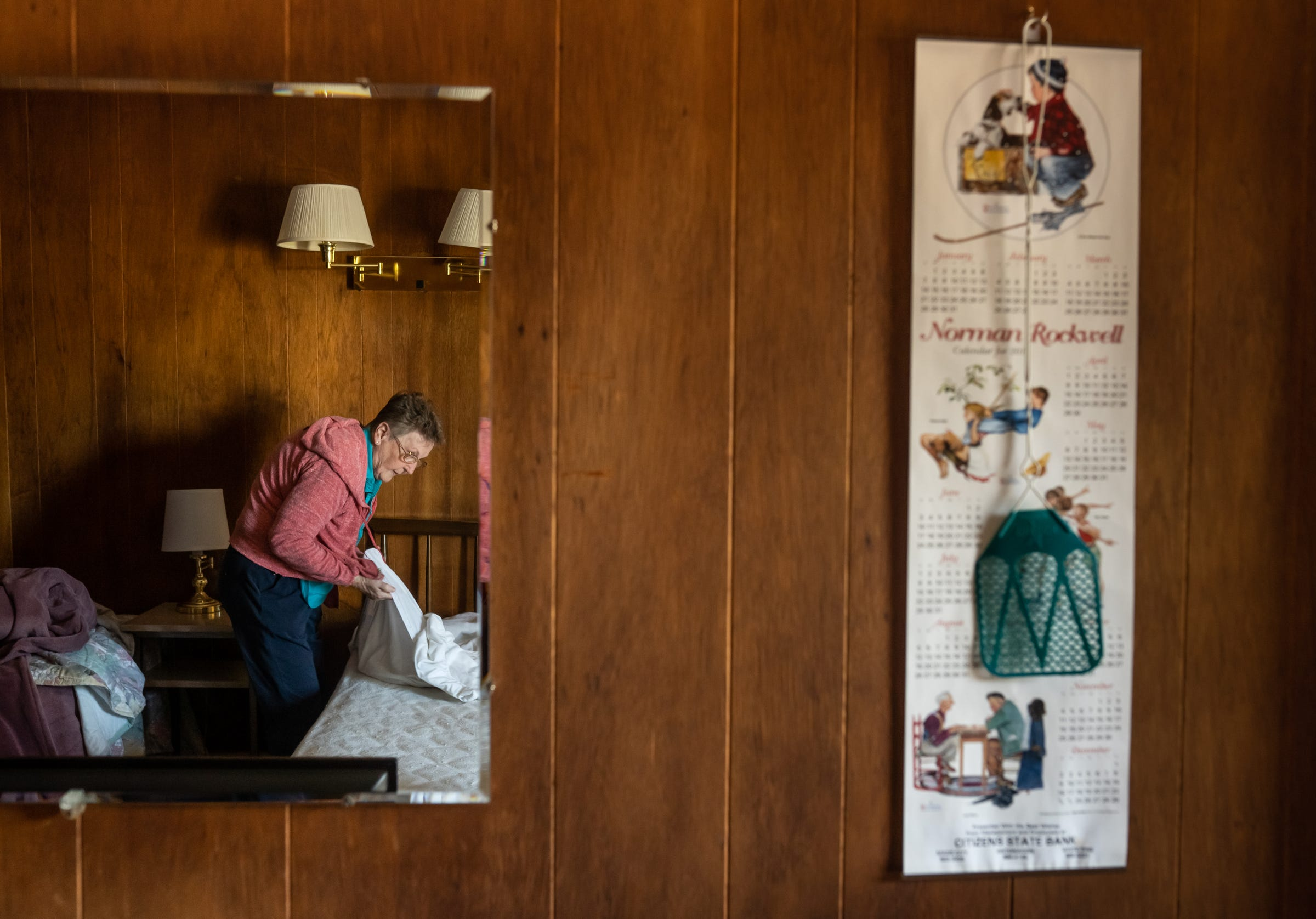 """Nancey Withrow cleans a room at the Adventure Motel in Mass City, Michigan on Thursday, Aug. 15, 2019, which she runs alone since her husband Donald died earlier this year. """"It's getting too hard to keep it up. You need somebody younger that deal with all of the people and do all the work,"""" she said."""