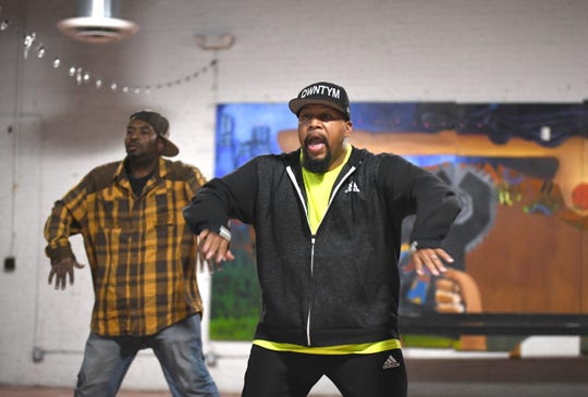 Ron Ford Jr. (right) rehearses with Juan Jones in the Funkateer style dance at the Cass Corridor Neighborhood Development. Ford Jr., a Kresge Artist Fellows, is a grant recipient in choreography, rehearsing for a mini-concert to be held November 23rd at the International Institute in Detroit.  He is an expert in the Funkateer style of Detroit dance from the 1970s, or as he calls it, just the Funk.