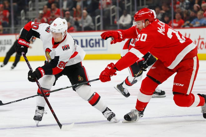 Red Wings defenseman Dylan McIlrath (20) defends against Senators center Vladislav Namestnikov (90) in the first period on Tuesday.