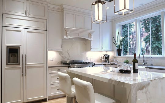 : Determining where the main refrigerator is going to be placed first in a design helps create a kitchen that really cooks. Michele Alfano Design made this Hoboken, New Jersey, townhome kitchen appear larger by cladding the refrigeration unit with panels and making it flush with the surrounding cabinetry.