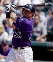 Larry Walker had a career batting average of .313, with 383 home runs and a career OPS of .965.