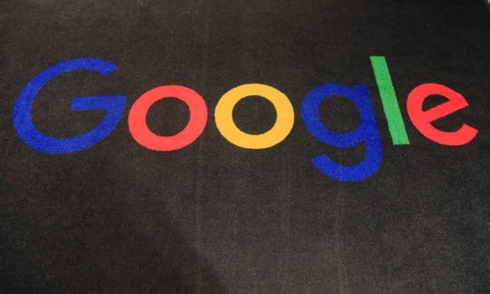 The logo of Google is seen on a carpet at the entrance hall of Google France in Paris, Monday, Nov. 18, 2019.
