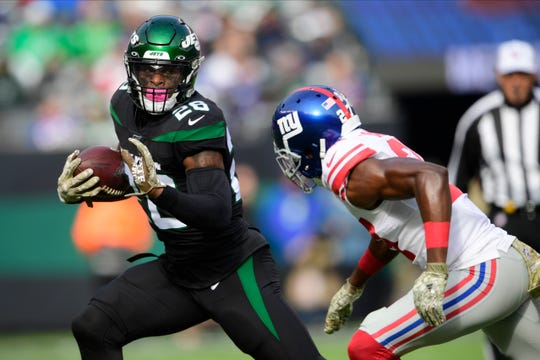 New York Jets running back Le'Veon Bell, a Michigan State product, says he has been unfairly targeted by the NFL after taking a fifth test this season for performance enhancers and criticizes the league's policy.