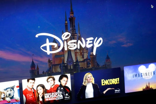In this Wednesday, Nov. 13, 2019 file photo, a Disney logo forms part of a menu for the Disney Plus movie and entertainment streaming service on a computer screen in Walpole, Mass.