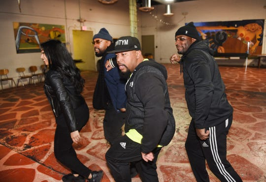 Lilanie Karunanayke (from left), Michael Manson, Ron Ford Jr. and James Broxton rehearse in the Funkateer style of dance at the Cass Corridor Neighborhood Development in Detroit.