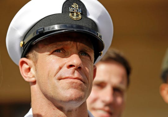In this Tuesday, July 2, 2019, file photo, Navy Special Operations Chief Edward Gallagher leaves a military court on Naval Base San Diego.
