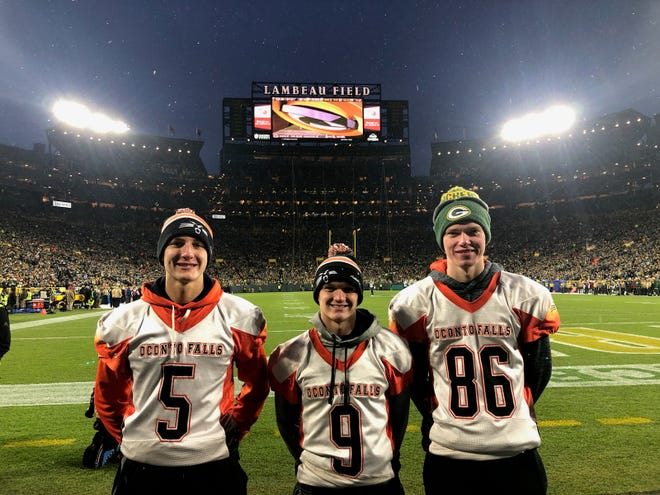 Joey Walters, Mitchell Manns and Jarod Parsons of the Oconto Falls football team participated in the High School Quarterback Challege during halftime of the Packers Nov. 10 game against Carolina.