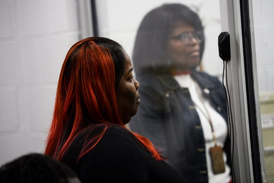 Luquise Baldwin, a cousin of David Edens Jr, 22, listens as Kodesha Lyuna Bryson, 25, speaks during her bond court hearing Wednesday, Nov. 20, 2019. Bryson was denied bond for the alleged murder and possession of a weapon during a violent crime in the death of David Edens Jr.