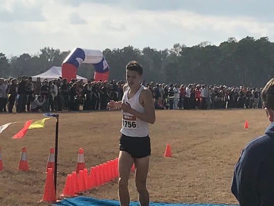 Greer's Coen Roberts crosses the finish line during the Class AAAA state cross country meet Tuesday in Camden