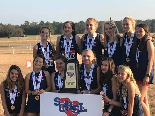 Greer Middle College celebrates its girls cross country championship Tuesday in Camden