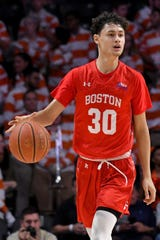 Boston University guard Javante McCoy (30)