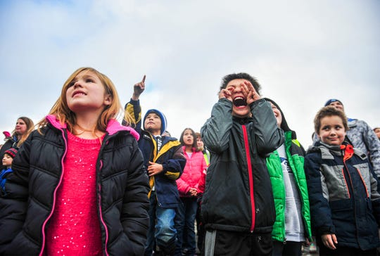 "Longfellow Elementary School students watch the ""topping out"" ceremony for their new school building on Wednesday, November 20, 2019.  The school has temporarily been relocated to the old Roosevelt Elementary School building while their new building is being constructed."