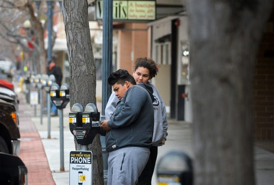 Juan Barragan feeds a parking meter in downtown Great Falls on Wednesday afternoon, November 20, 2019.