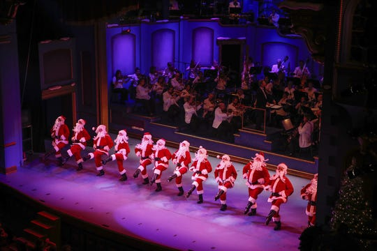 Tap dancing Santa's entertain the crowd during the 31st year of IPL Yuletide Celebration at the Hilbert Circle Theatre on Dec. 1, 2016.