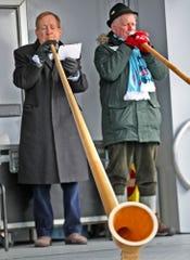 Carmel Mayor Jim Brainard, left, joins others playing alphorns during the Carmel Christkindlmarkt soft opening, Wednesday, Nov. 13, 2019.  The festival runs Nov. 16 through Dec. 24 in Carmel.