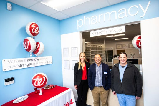 Employees Jen Neinhaus, Tom Truong, and Molly K. pose for a photo during the grand opening event at a Community Walgreens, Wednesday, Nov. 20, 2019, at 1029 South Riverside Drive in Iowa City, Iowa.