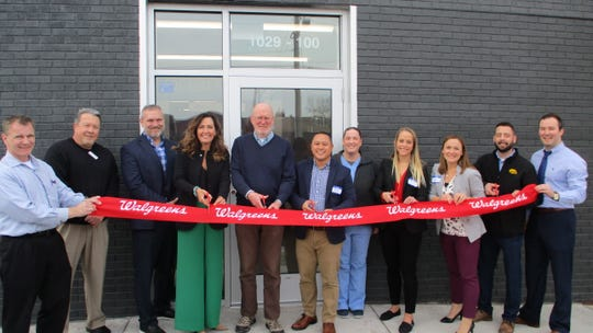 "Members of the Walgreens Company, both locally and regionally, gather at 1029 South Riverside Drive for the grand opening of the ""Comunity Walgreens"" on Wednesday, Nov. 20. Community members such as Mayor Jim Throgmorton were also in attendance."
