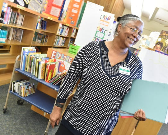 Volunteer Cassandra Stovall visits Lake Elementary in Jackson, Miss., on Wednesday, Nov. 20, 2019, for a Book Buddies session. Stovall is a former librarian at the school and a longtime Girl Scouts troop leader.