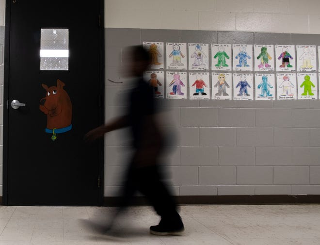 Kendarius Dupree's artwork is displayed on the doors of kindergarten classrooms at Lincoln Elementary School in Jackson, Tenn. Dupree painted on cartoon characters such as Tom & Jerry, Snoopy, Batman and a caterpillar.