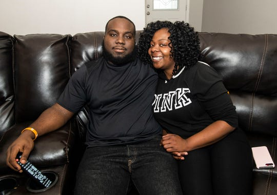 Brandecias and Ivory Dodd sit together in their Jackson home on Nov. 19, 2019. The pair met in high school at North Side in Jackson and have been together for 10 years.