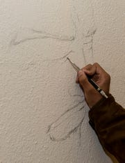 Kendarius Dupree sketches a portrait of Jesus Christ at Unity Temple Church in Jackson, Tenn., Tuesday, Nov. 19, 2019. Dupree has over 1,000 community service hours, which is more than the requirements for Jackson Central-Merry Early College High.  (CORRECTION: A previous caption misnamed the church. It has been updated with the correct information.)