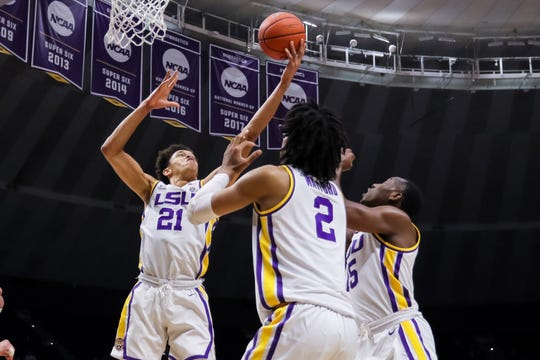 Nov 19, 2019; Baton Rouge, LA, USA; LSU Tigers forward Courtese Cooper (21) secures a rebound against the UMBC Retrievers during the second half at Maravich Assembly Center. Mandatory Credit: Stephen Lew-USA TODAY Sports