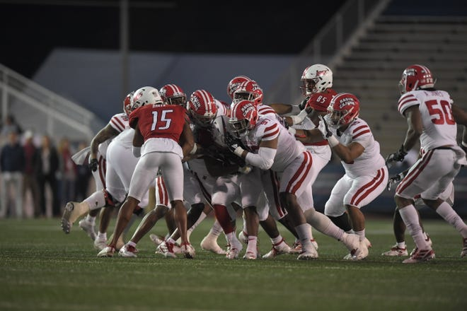UL defensive lineman Ja-Quane Nelson (97, front) is on the stop during Saturday's win at South Alabama.