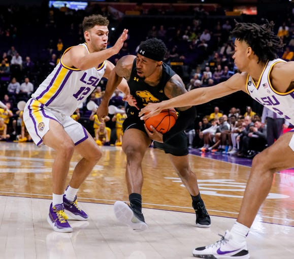 Nov 19, 2019; Baton Rouge, LA, USA;  UMBC Retrievers guard K.J. Jackson (3) is fouled by LSU Tigers forward Trendon Watford (2) during the second half at Maravich Assembly Center. Mandatory Credit: Stephen Lew-USA TODAY Sports