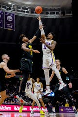 Nov 19, 2019; Baton Rouge, LA, USA; LSU Tigers guard Charles Manning Jr. (11) shoots a jump shot against UMBC Retrievers guard Keondre Kennedy (0) during the first half at Maravich Assembly Center. Mandatory Credit: Stephen Lew-USA TODAY Sports