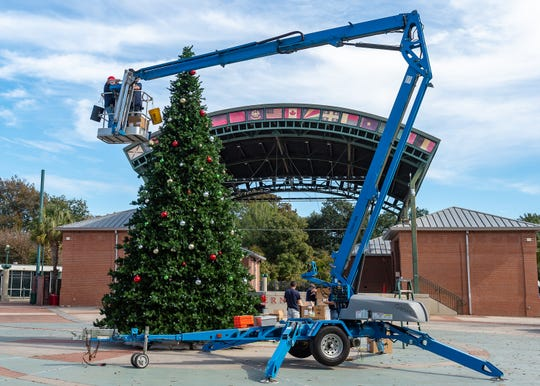 Workers begin decorating Christmas Tree in Parc International. Lafayette. Wednesday, Nov. 20, 2019.