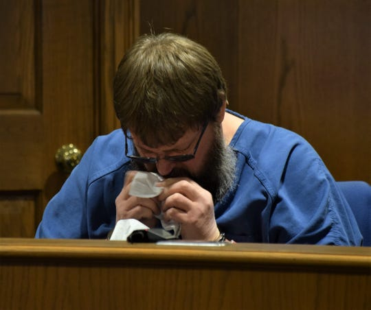 Frederick Bellomy, wipes his face as he listens to the victim impact statements in his sentencing hearing Wednesday, Nov. 20. He was sentenced to 14 years in prison after he pleaded guilty to one count each of rape and importuning.
