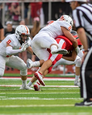 Brighton senior Zach Pardonnet (2) makes one of his six tackles in the season opener against Livonia Churchill.
