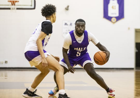 Male senior guard Tyren Moore (5) attempted a crossover dribble during the Bulldogs' practice. Wednesday, November 20, 2019.
