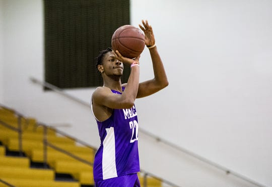 Male senior forward Noah Courtney (22) launched a three during the Bulldogs' practice. Wednesday, November 20, 2019.