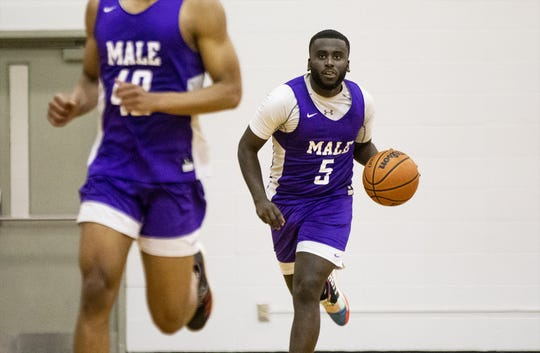 Male senior guard Tyren Moore (5) brought the ball upcourt during the Bulldogs' practice. Wednesday, November 20, 2019.