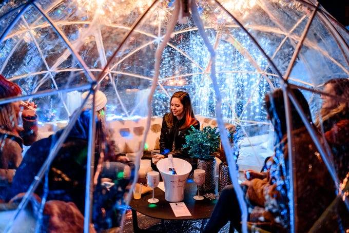"""8UP Elevated Drinkery & Kitchenin downtown Louisville brought six fully enclosed """"igloos"""" toits eighth-floor patio on West Chestnut Street."""