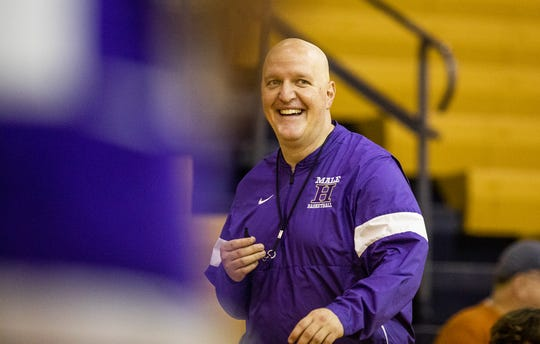 Male head basketball coach Tim Haworth cracked a smile during the Bulldogs' practice. Wednesday, November 20, 2019.