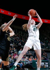 Michigan State's Julia Ayrault, right, shoots against Oakland's Autumn Kissman, Tuesday, Nov. 19, 2019, in East Lansing, Mich. Michigan State won 76-56.
