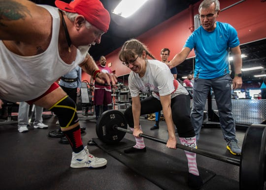Retired powerlifter Dan Norton trains Kourtney Krebs for an upcoming weightlifting event at ATC Fitness in Collierville, Tenn., on Thursday, Nov. 14, 2019.
