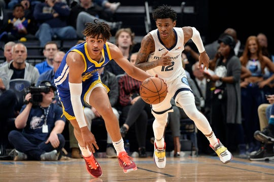 Golden State Warriors guard Jordan Poole, left, brings the ball up ahead of Memphis Grizzlies guard Ja Morant (12) during the first half of an NBA basketball game Tuesday, Nov. 19, 2019, in Memphis, Tenn. (AP Photo/Brandon Dill)