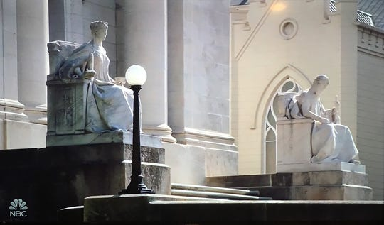 """The D'Army Bailey Shelby County Courthouse and St. Peter Catholic Church appear to be almost literally mashed together in this evocative shot from episode 9 of """"Bluff City Law,"""" which dealt with collision between church and state."""