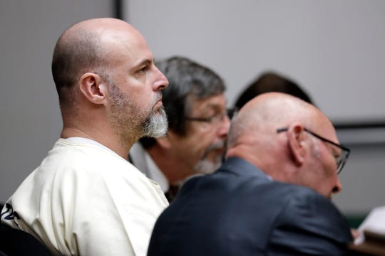 Curtis Watson, left, attends a preliminary hearing Wednesday.