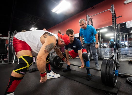 Retired powerlifter Dan Norton trains Kyle Krebs for an upcoming weightlifting event at ATC Fitness in Collierville, Tenn., on Thursday, Nov. 14, 2019.