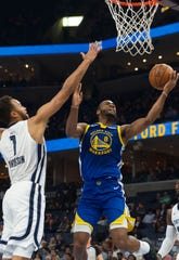 Golden State Warriors guard Alec Burks (8) goes to the basket against Memphis Grizzlies forward Kyle Anderson (1) during the first half at FedExForum on Tuesday.
